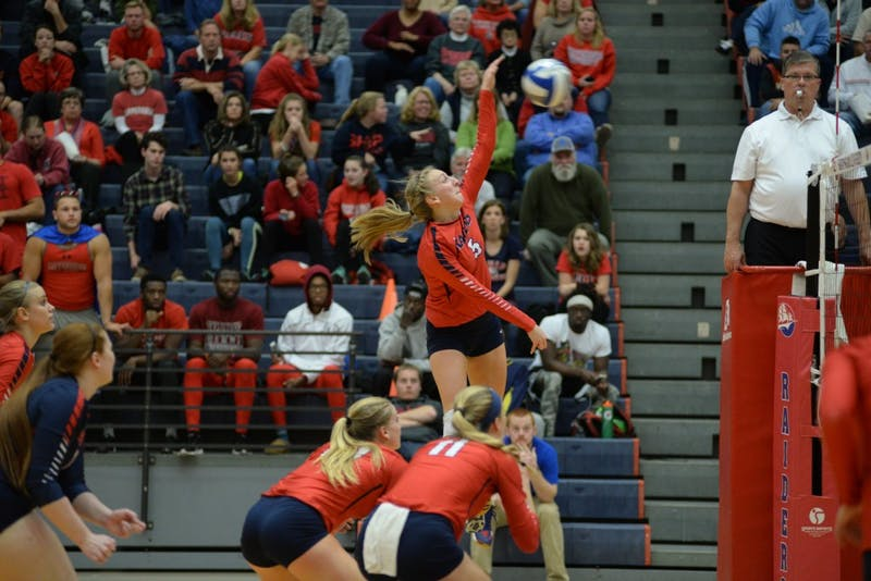 Courtney Malott towers above her teammates to respond to a volley.