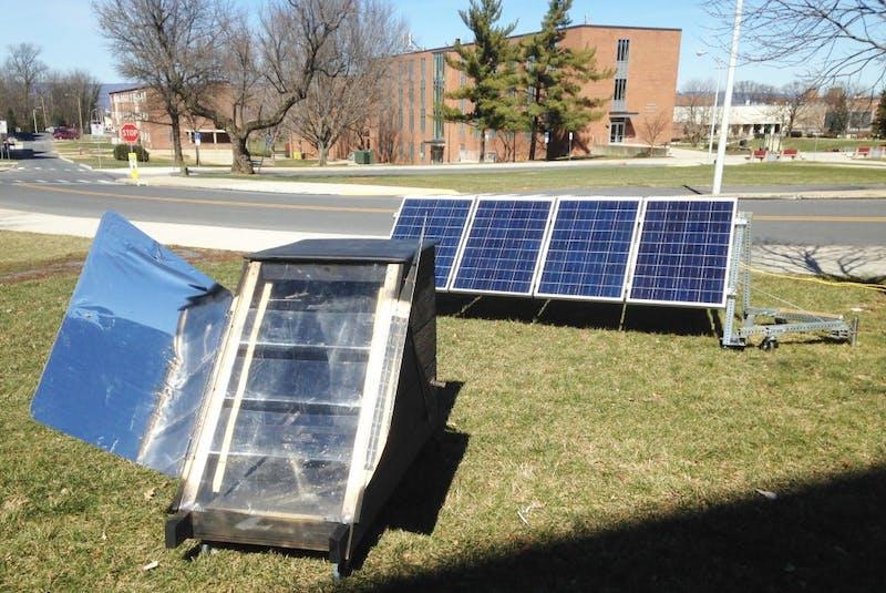 The 'Veggie Kiln' uses energy from solar panels behind Huber