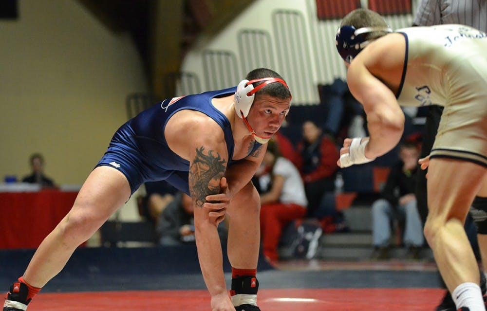 Wrestling falls to Golden Bears in final match of regular season