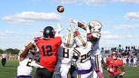 David Balint III (No. 12) is swarmed by a host of West Chester defenders on the Red Raiders' hail mary attempt as time expires.