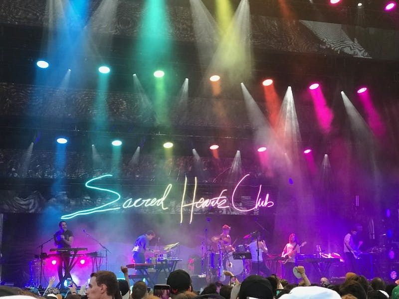 Foster the People honors pride month with their stage lighting, displaying the colors of the rainbow during their performance.