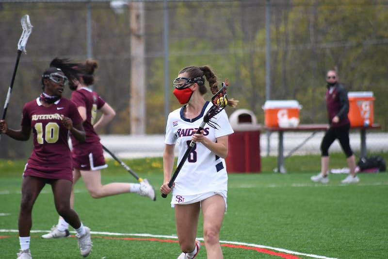 Hannah Raines cradles the ball in Saturday's 12-11 win over Kutztown.