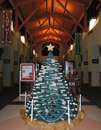 The holiday book tree is located in the atrium of the Fredricksen Library in Camp Hill. The project began in 2013 and raises money for the library.