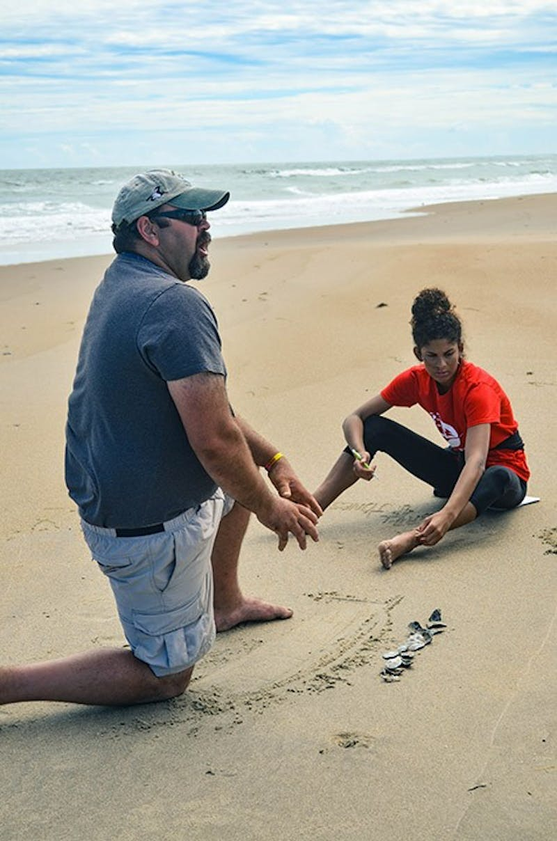 Sean Cornell teaches his coastal hazards and sustainability course about coastal erosion and efforts to stop its impact. Cornell is one of many PASSHE professors who teach courses at Chincoteague Bay Field Station over the summer.