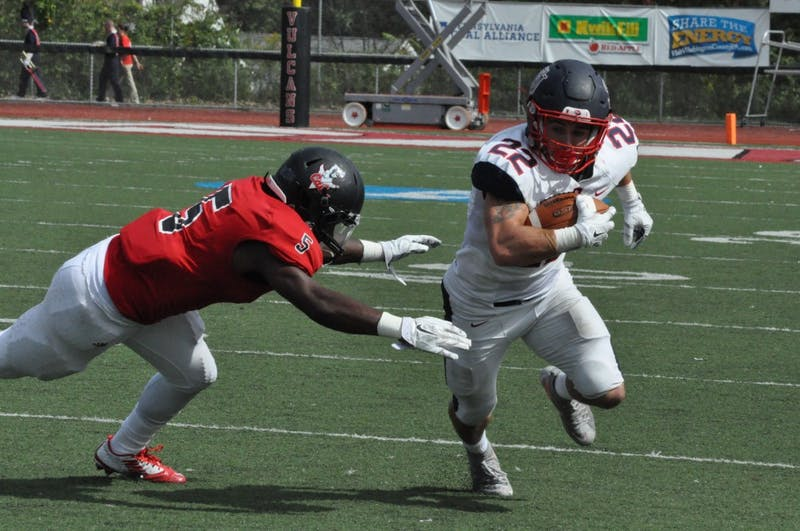 SU running back Justin Pyle escapes a tackle in the loss to California University.
