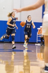 In her season with The Hill School in Pottstown, Pennsylvania, Nealon (dribbling ball) averaged 12 points, three assists and two steals per game. Her 2019 campaign earned her Team MVP honors.