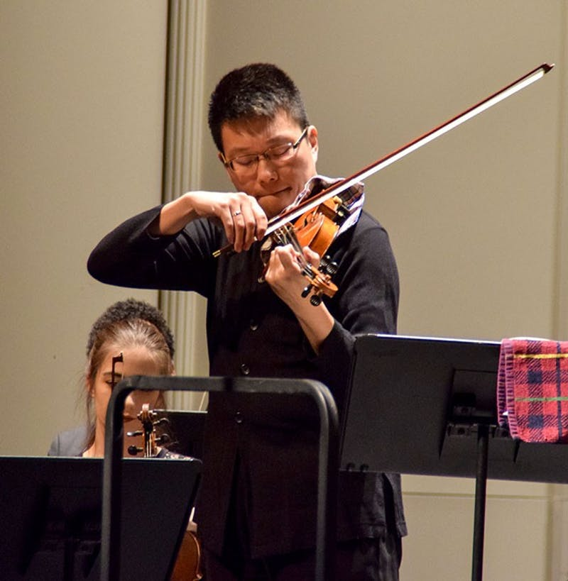 Guest performer Lin He from Louisiana State University played his violin with absolute precision and authority during SU's Community Orchestra performance.