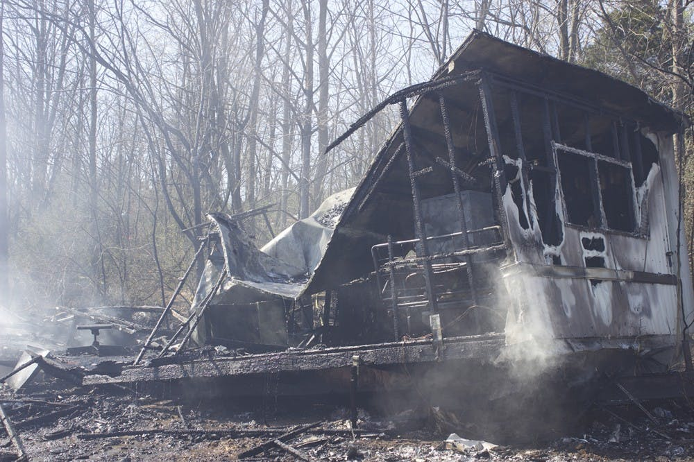 Brush fire destroys vacant mobile homes