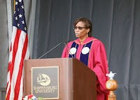 Shippensburg University President Laurie Carter greets graduates and their families at the combined ceremony.