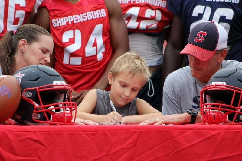 Six-year-old Gunnar Downie of Chambersburg signs a letter of intent to become a member of the SU football team. This was made possible by the Friends of Jaclyn Foundation, which helps children with pediatric cancer.