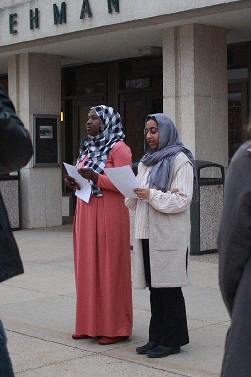 Amadou Kindo (left) and Kanza Amin remember  victims of the mass shooting in New Zealand.