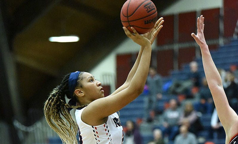 Aunbrielle Green attempts a 3-pointer during the Raiders' win over Bloomsburg University on Saturday at Heiges Field House. Green scored 11 points and grabbed seven rebounds in the victory that clinched a first-round bye for SU.