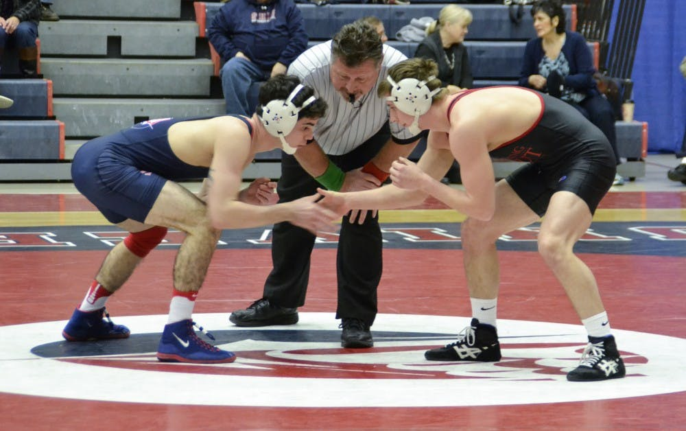 Wrestling wins two of three on Alumni Day