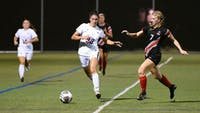 Lauren Ocker pushes the ball up the sideline during the Raiders' 3-1 loss to East Stroudsburg. Ocker took four shots, including one on goal in the loss.