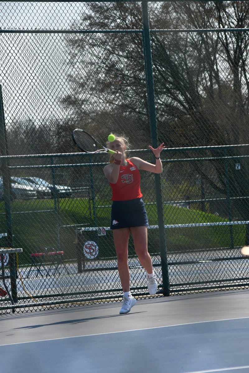Junior Jenna Sluymer in game action earlier this season. Sluymer smashed competition Saturday in her singles match.