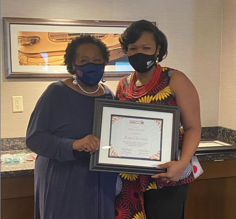 Kapri Brown, right, won the staff member Gero award and she was nominated by Diane Jefferson, left. The winners were honored April 30.