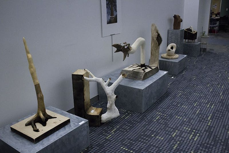 Art students crafted sculptures out of natural wood and milled wood for a class assignment.
