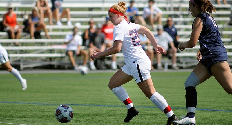 Junior Mara Bowman looks to set up a teammate against Shepherd's defense Wednesday afternoon.