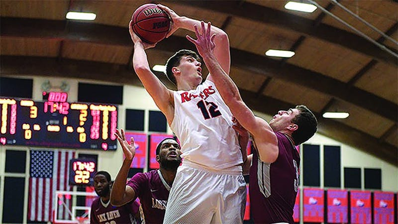 SU's Dustin Sleva, led the Raiders with 15 points against La Salle College, but the Raiders dropped the exhibition against the Division I foe, 74-60, in Philadelphia.