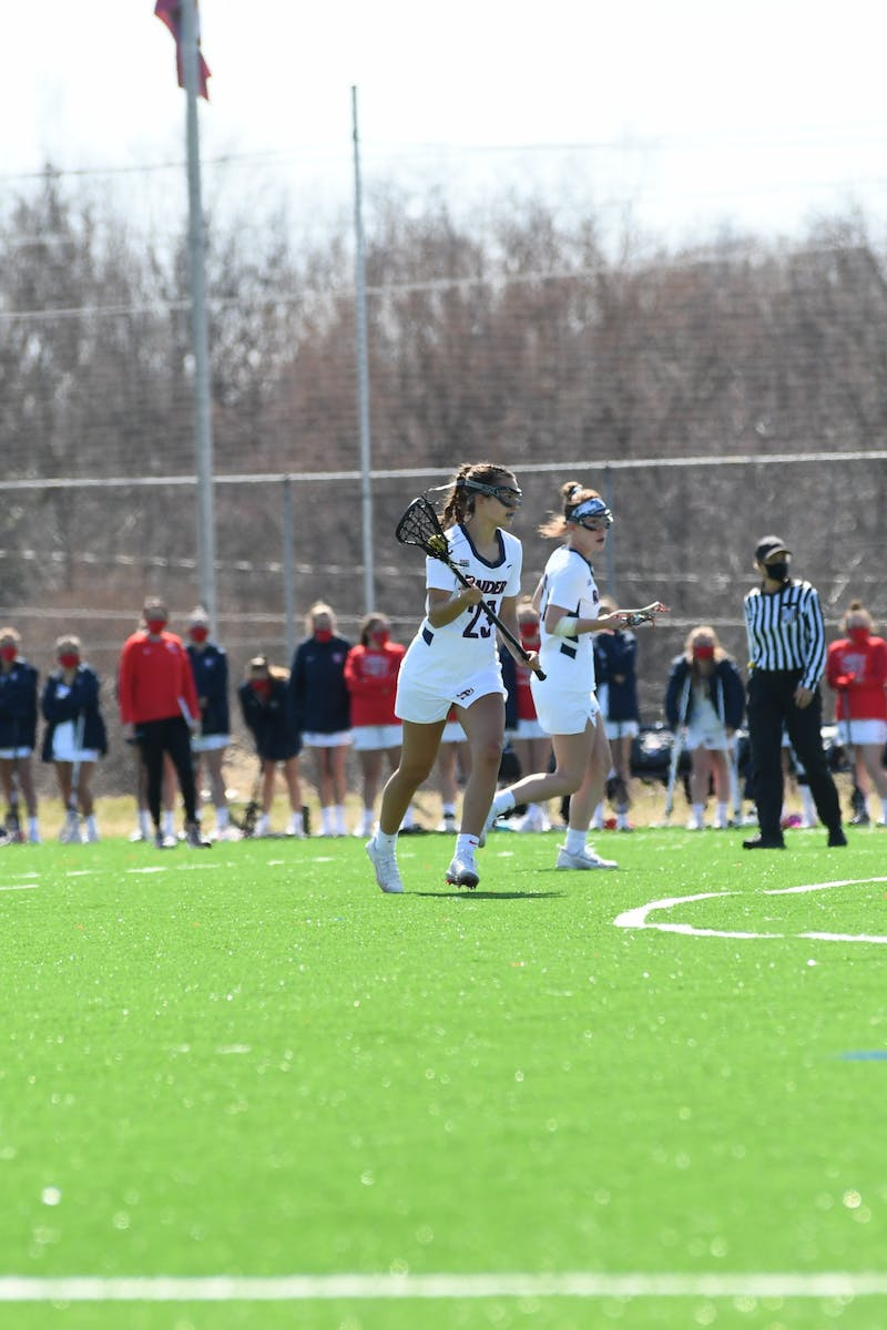 Gabby Savarino (left) and Hannah Seifried (right) set up the offense in a game earlier this season. Both tallied hat tricks this week in two games.