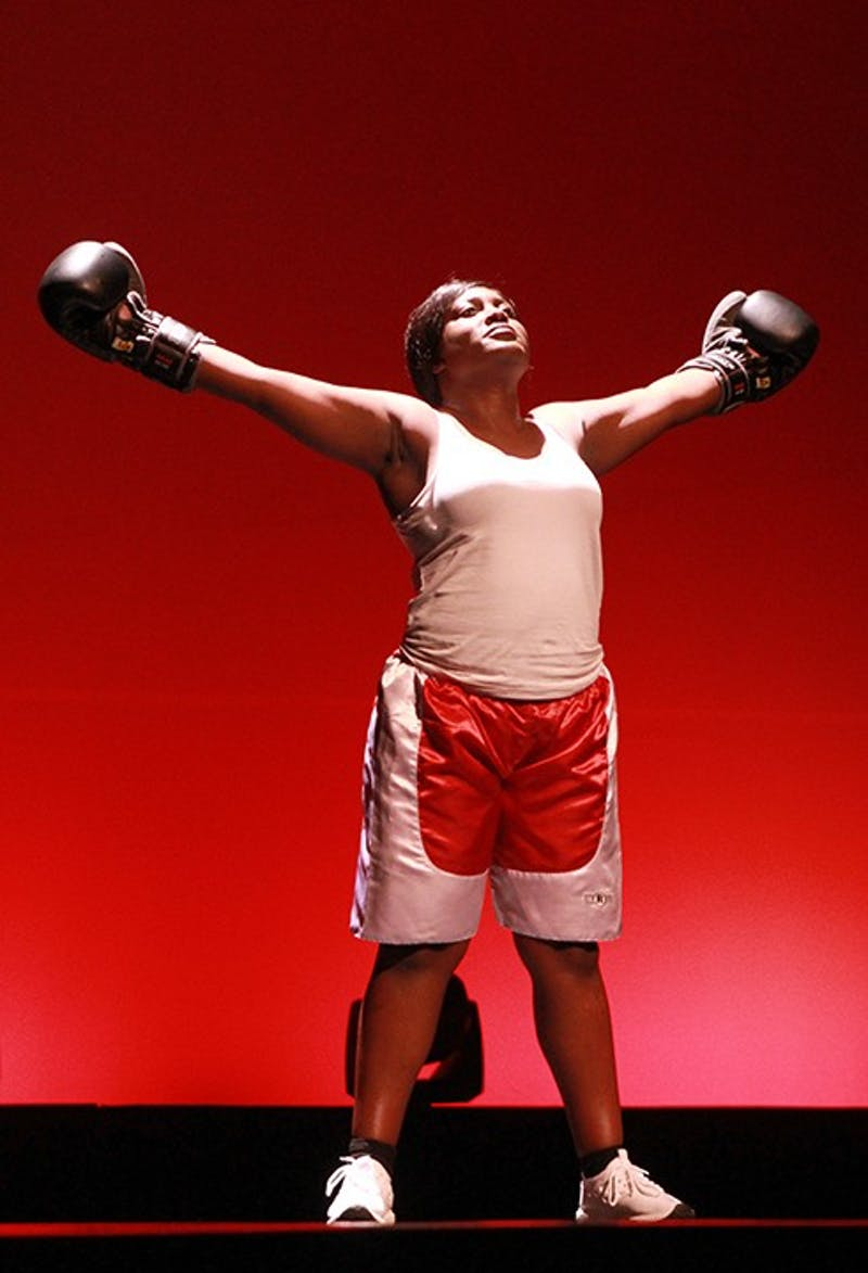 Talynna DeVoue danced and pretended to box while dressed as Laila Ali, Muhammad Ali's daughter.