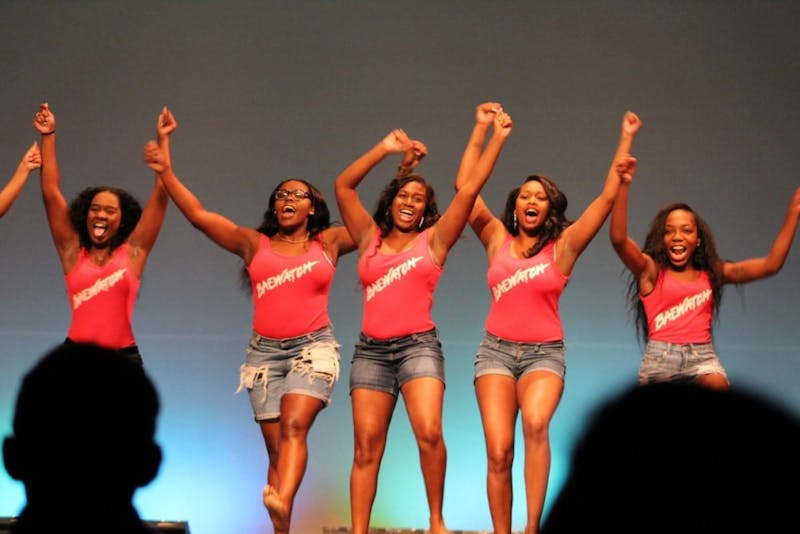 Members of SU's Heritage Dance Co. celebrate their 2016 victory at the homecoming Lip Sync competition in the category of large group.
