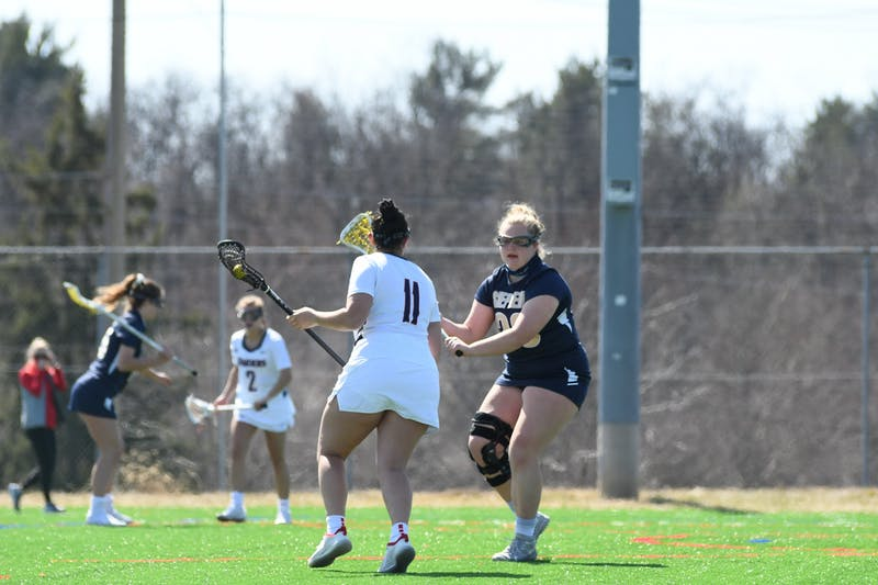 Sophomore Sydney Costanza (No. 11) goes head-to-head with a Shepherd University defender last Saturday.