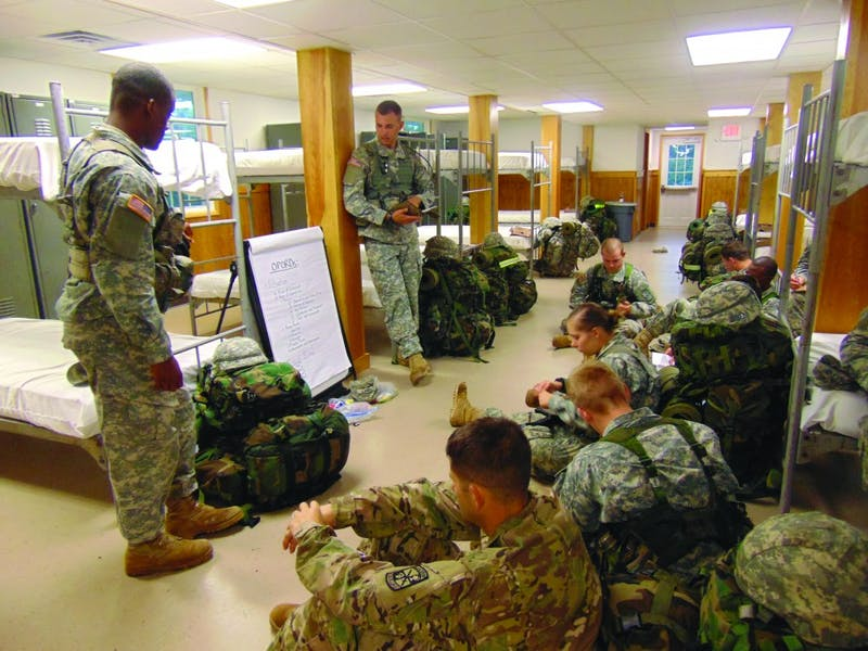 Junior Cadets receive instructions on operations orders (OPORDs) from seniors Dan Kinney and Laquon Brown.