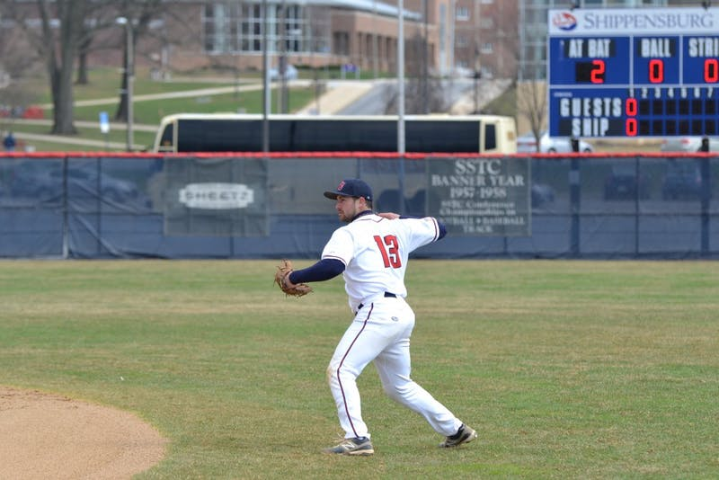 Jimmy Spanos throws out a Golden Bear runner from deep in the hole at second base.