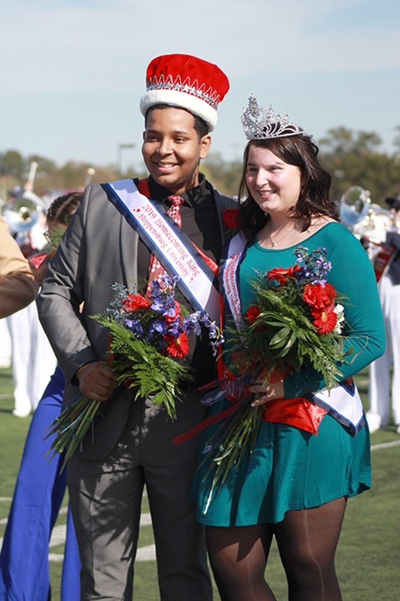 Homecoming King and Queen, Ramses Ovalles and Eliza Eames, smile after being crowned during halftime of Saturday's Homecoming football game. The Homecoming Court raised $10,932.86 for Shippensburg Produce Outreach.