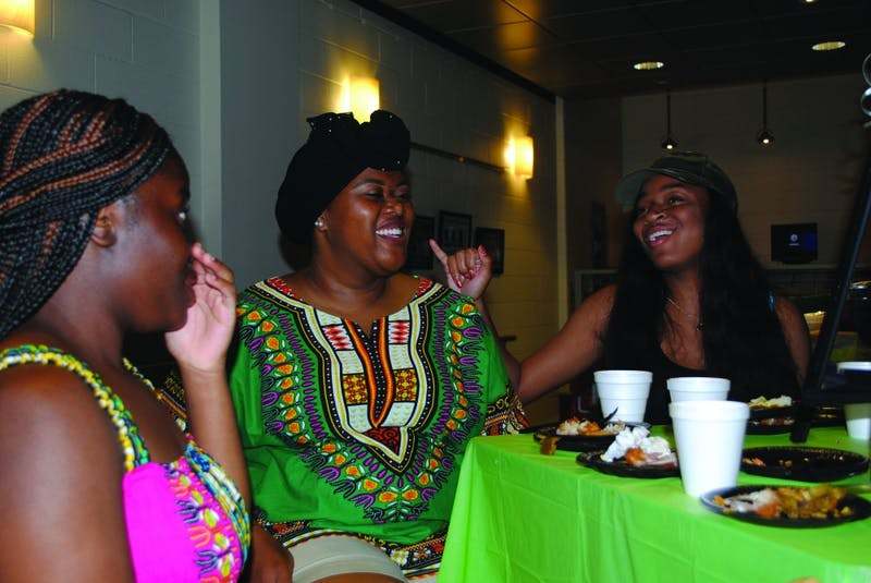 From left to right: Marina Gbegnon, Waliyah Savoy-Hill and Alexia Hylton gather in McFeely's cafe to enjoy a variety of African meals and music and to learn and embrace African culture.