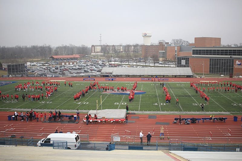 Students stand on the field in Seth Grove Stadium to spell out SHIP. The flash mob kicked off the first of many events that are part of president Carter's 17 days of kindness.