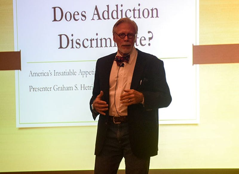 Graham Hetrick speaks to the audience about America's opioid crisis and how many ignore the problem until they are personally affected by it. He proposed that Americans develop a healthier lifestyle and spend time helping others.