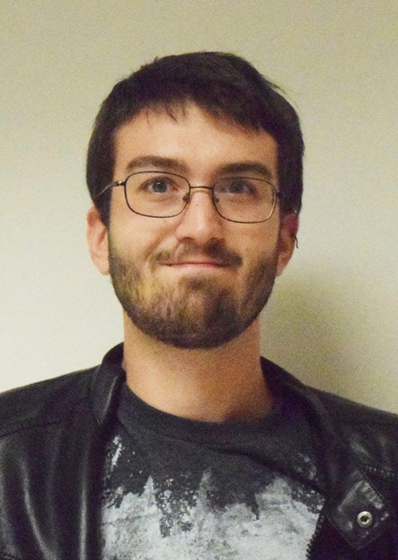 Troy S. Okum, News Editor