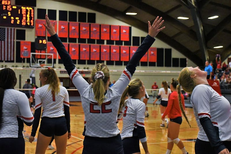 The volleyball team celebrates its thrilling five-set victory over conference rival Shepherd University.