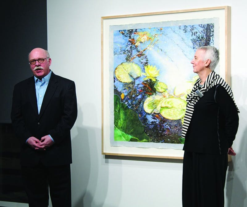 Michael Campbell, director of the Kauffman Gallery (left) and Sique Spence, director of the Nancy Hoffman Gallery, opened the exhibit to the general public last Wednesday. Spence walked the community through the exhibit, explaining the artist, background and significance of each piece.