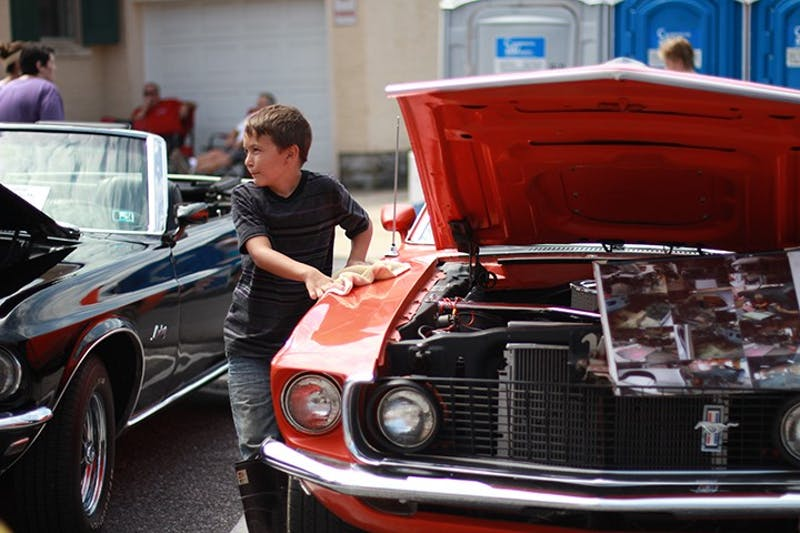 A young member of the Shippensburg community examines cars at the festival's antique auto show.