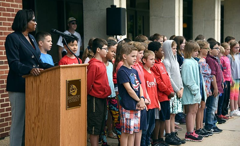 Shippensburg University President Laurie Carter reads the Preamble of the Constitution with Grace B. Luhrs University Elementary School students outside the Ezra Lehman Memorial Library on Sept. 7.