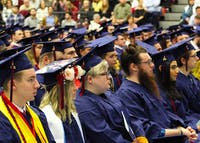 Shippensburg University graduates listen to commencement speaker Khalid Mumin ('95) during the winter 2019 graduation ceremony.