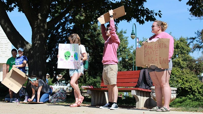 Members of the Green League, an environmental club at Shippensburg University, held signs in the academic quad as part of global climate protests to demonstrate their grievances with climate change.