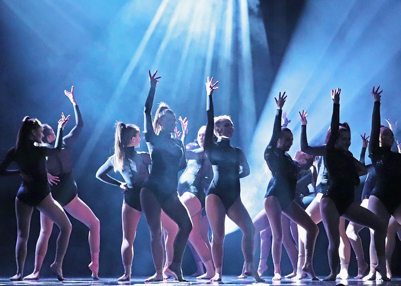 "The In-Motion Dance Troupe opened their performance dancing to the song ""Strip"" with a routine choreographed by Reilly Bedsem and Brooke Hull."