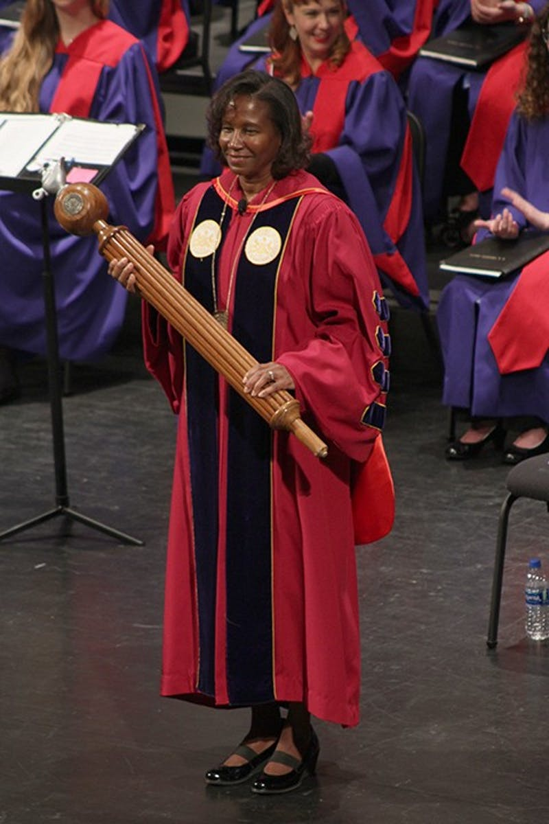 President Laurie Carter stands in front of the Shippensburg University community with the ceremonial mace moments before addressing the crowd.