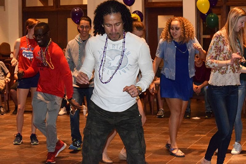 SU Modern Languages Professor José Ricardo Osorio teaches attendees his own dance moves.