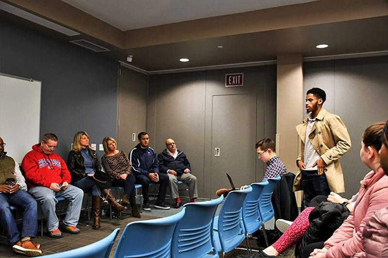 Lance Hines-Butts asks the panelists about making  welcome programs for transfer students. Students can ask questions and voice concerns during the President's Hours held in residence halls throughout the semester.