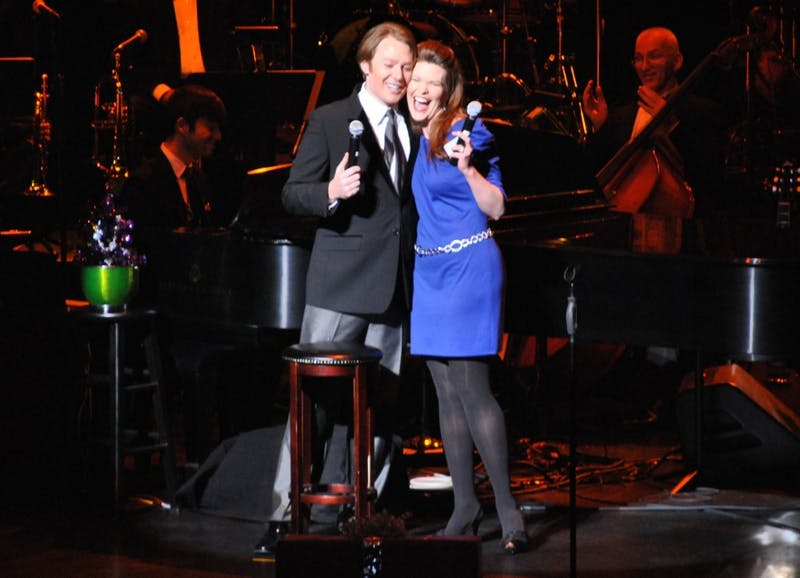 "Clay Aiken and Sarah Timm from Sight and Sound Theaters share a hug after performing ""Sleigh Ride"" together."