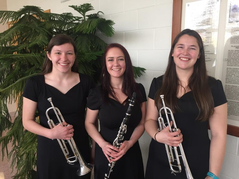 During placement auditions for the Intercollegiate Band Festival, Maggie Myers (left) places first chair for first trumpet, Leann Helfrick (middle) places second for second clarinet and Maria Trace (right) places fourth for third trumpet.