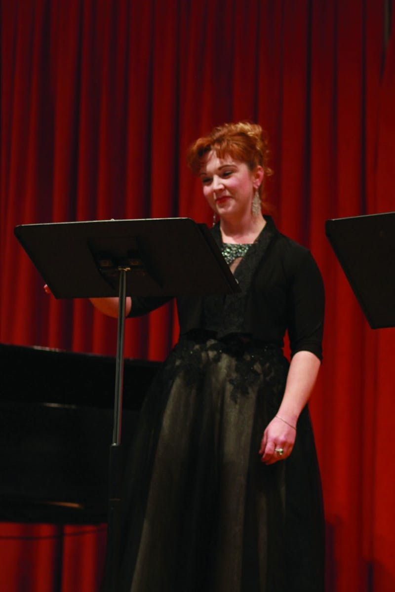 Elizabeth Shoenfelt sings in a high and operatic soprano voice. In addition to performing last Wednesday, she directs the SU choirs and on occasion lends her voice to other ensembles.