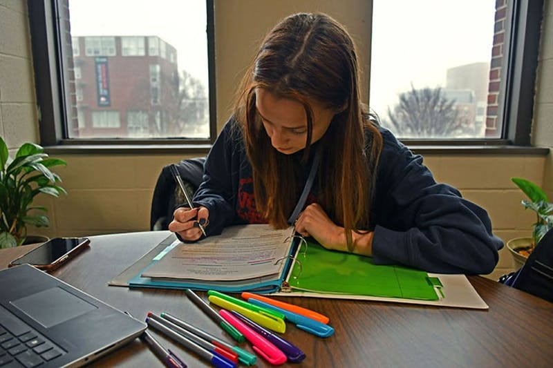 Student Adora Schmid studies in one of the study areas found in the library equipped with a binder, highlighters and pens to take proper notes for class.