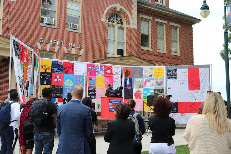 """The annual ACT Rally was held during Diversity Week this year and ACT unveiled the """"A Quilt to Cover Us All"""" project. The 100-panel quilt was created by different student groups to show SU's diversity."""