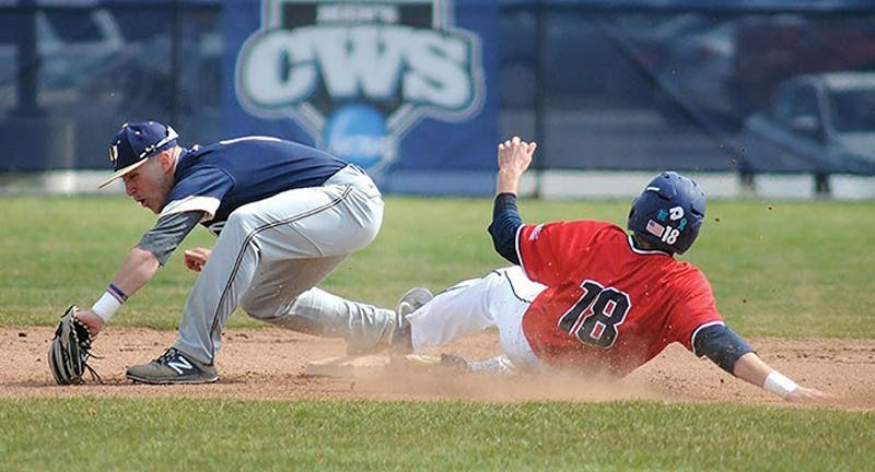 SU's Tommy Baggett, right, slides safely into second during the Raiders' 12–11 comeback win on Tuesday.